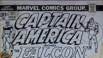 Stat – Copies of original art cut out and glued on to original art.  Quite often word bubbles and the title is stats. Shown is a close-up from the Captain America #171 cover by John Romita.